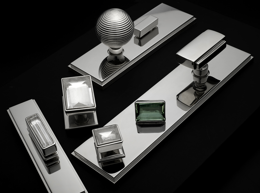 Ensemble of modern hardware in polished nickel and custom rock cystal pulls